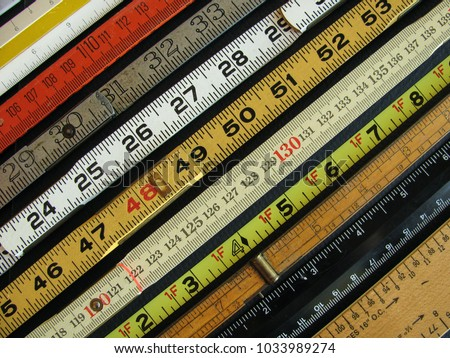 Old rulers both metric and inches, scales and measuring tools represent measurement, metrics, precision, accuracy and results. - Shutterstock ID 1033989274