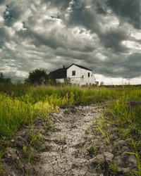Old rundown house with storm clouds overhead