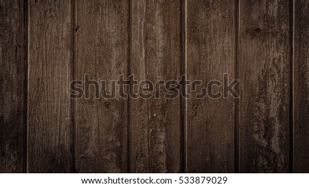 Old rural wooden wall in dark brown colors, detailed plank photo texture. Natural wooden building structure background. #533879029