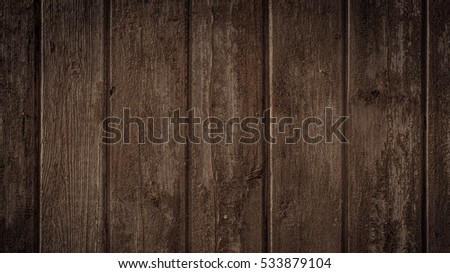 Old rural wooden wall in dark brown colors, detailed plank photo texture. Natural wooden building structure background. #533879104