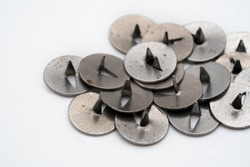 Old russian pins called kopka. Lots of metallic pins. white background and high resolution macro image. Sharp pointi metal neeldes / pins. Tools for organising board.