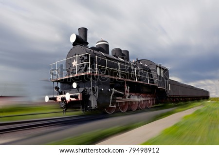 Old russian steam locomotive with motion blur