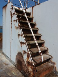 old rust stair on the ship in japan, white wall rust