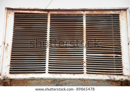 old rusted broken air conditioner fan