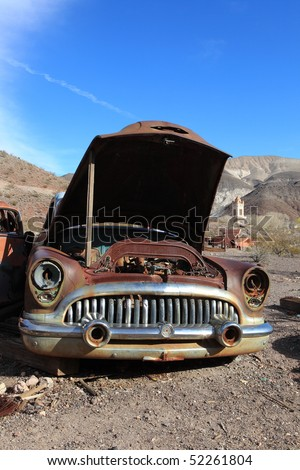 Old rusted car in junk yard . National park Death valley