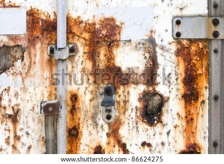 Old rusted cargo container door closeup texture