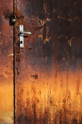 Old rusted door with padlock