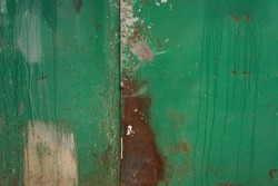 Old rusted green wall. Grunge background. Distressed texture