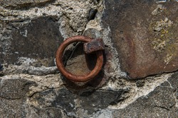 Old Rusted iron ring embedded in harbor wall