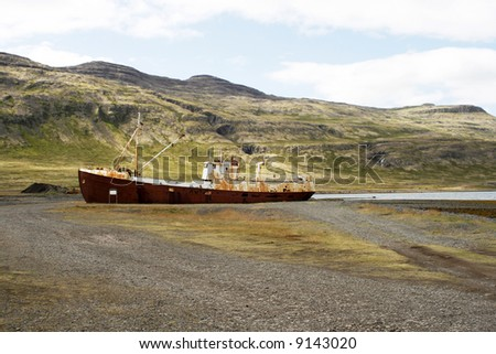 old rusted ship stranded on land