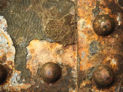 Old rusted steel - rusty metal texture. Big rusty metal plate, rust and corrosion. Bolts