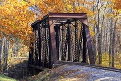 Old rusted train bridge over a river