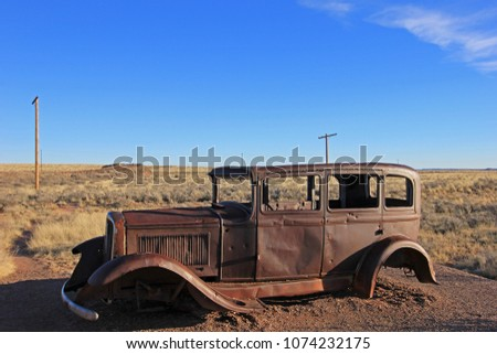 old rusted vintage car along...