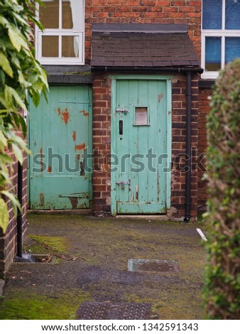 Old rustic and weathered door, outside toilet, privy, Victorian schooling,