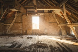 Old Rustic Attic with Sunlight coming through Window.