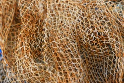 Old rustic fishing nets, fishing nets texture.