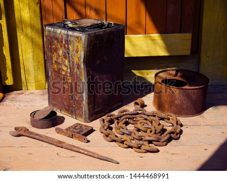 Old rustic gardening farm tools and utensils on the porch of a village house. The concept of agriculture, husbandry, horticulture and landscaping. #1444468991