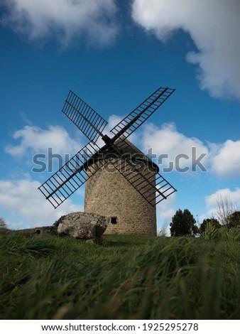 Old rustic historic windmill building on a hill Mont Dol moulin Dol de Bretagne Saint Malo Ille et Vilaine Brittany France Europe Photo stock ©