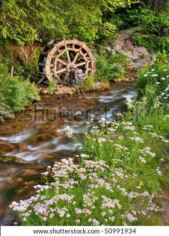 old rustic water wheel on mill...
