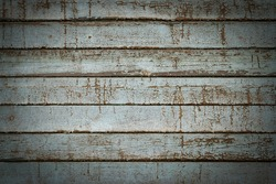 Old rustic wooden planks with shabby peeling paint. Light gray vignetted texture or background (horizontal 3:2 format). Empty template for design, copy space