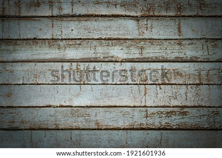 Old rustic wooden planks with shabby peeling paint. Light gray vignetted texture or background (horizontal 3:2 format). Empty template for design, copy space Stockfoto ©