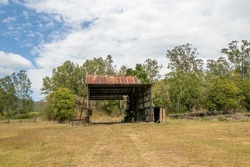 Old rusting maintenance shed left over from Finch Hatton Mill circa 1906-1990, Mackay, Queensland, Australia