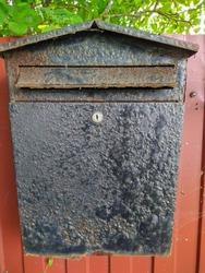 old rusty and black metal mailbox closeup photo