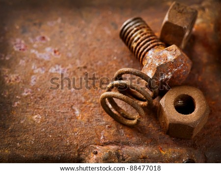 Old rusty bolts and steel nuts