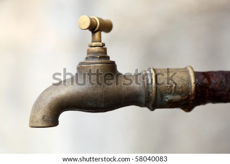 Old rusty brass water tap - stock photo