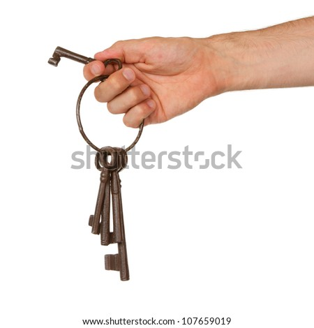 Old rusty bunch of keys in hand, isolated on white
