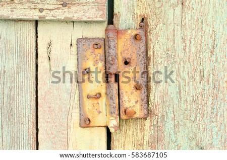 old rusty carport on a wooden door