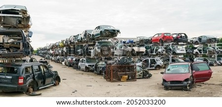 Old rusty corroded and crushed cars in car scrapyard. Car recycling.  Ecological concept by dump of wrecked cars.  Photo stock ©