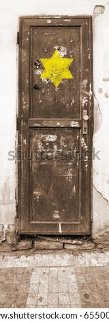 Old rusty, dirty door with a sign Worn Star of David. Allegory of holocaust