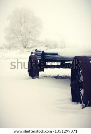Old rusty farm equipment in a very cold, snowy winter scene, Country scene