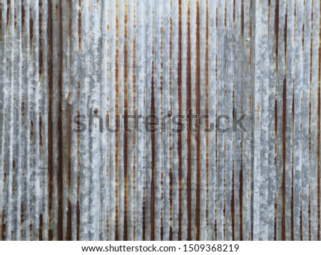 Old rusty galvanized, corrugated iron siding texture background.A rusty corrugated iron metal texture background. Old rusty zinc plat wall, Zinc wall ,rusty Zinc grunge background.