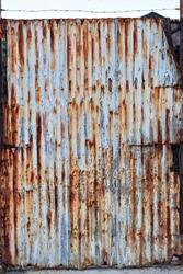 Old rusty galvanized, corrugated iron siding vintage texture background of grunge.