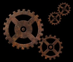 Old rusty gears isolated on black background