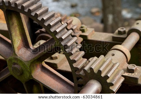 Old rusty gears, machinery parts.