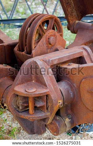 Old rusty gears or mechanical parts, crane mechanism closeup