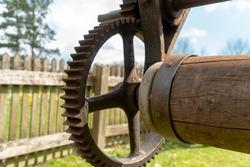 Old rusty gearwheel on a windmill