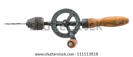 old rusty hand drill isolated over white