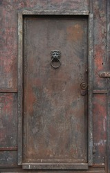 Old, rusty, heavy iron door.