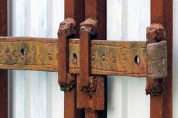 Old rusty iron hasp. Close-up.