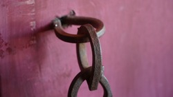 Old rusty iron ring close up image with a solid iron ring to secure on the old door and  surface