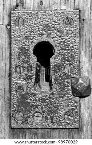 old rusty key hole b&w