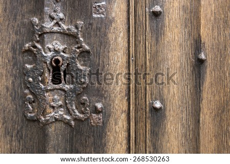 Old Rusty Keyhole with Antique Wooden Door