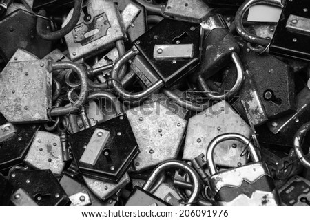 Old rusty locks and keys at flea market in Paris. Aged photo. Black and white.