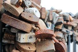 old rusty love locks on the bridge railing close up