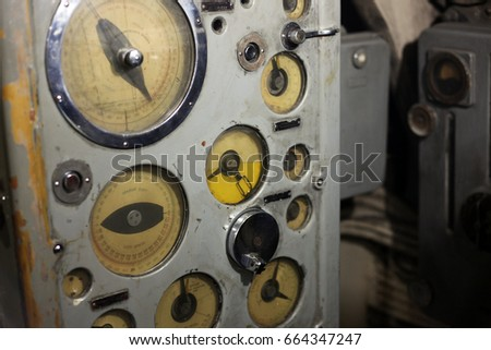 Old rusty machinery/industry control panel. Gauge level and engine meter #664347247