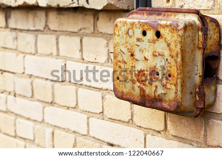 Old rusty mail box on the wall